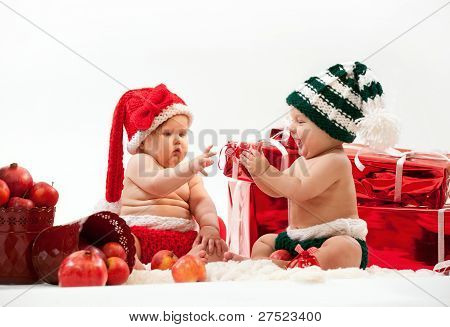 Two cute babies in Christmas costumes