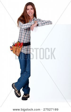 Handywoman with white panel for message