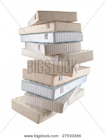 pile of ten mattresses isolated on white