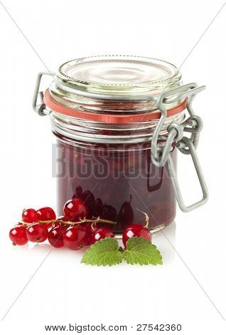 jar of red currant jam and fresh fruit
