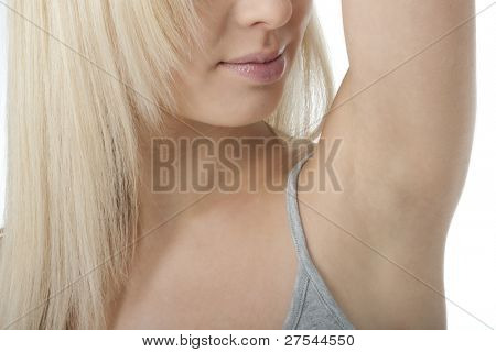 Portrait of pretty woman looking her clean fresh armpit