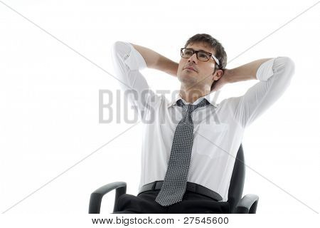 Relaxed businessman with hands behind his head