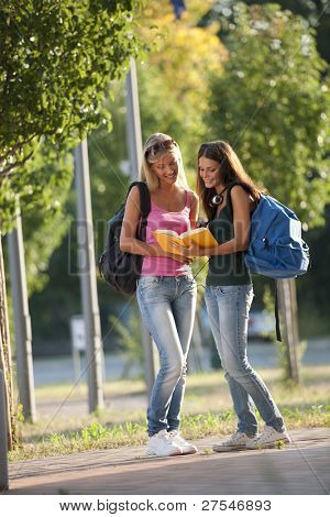 Beautiful female students outdoors