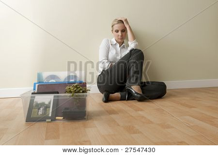 Depressed businesswoman loosing her job due to corporate downsizing