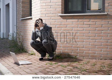 Depressed businesswoman outdoors
