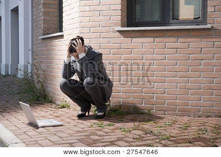 Depressed businesswoman outdoors