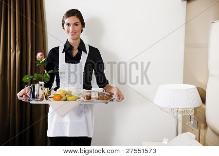 Happy Maid Carrying Breakfast Tray