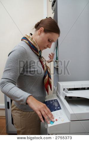 Woman Printing A Documents.