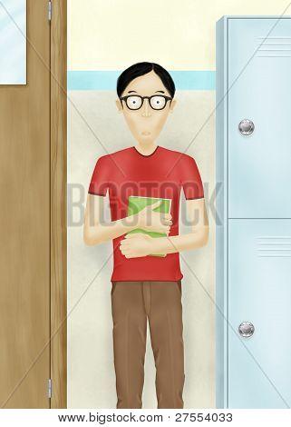 Schoolboy with book in school