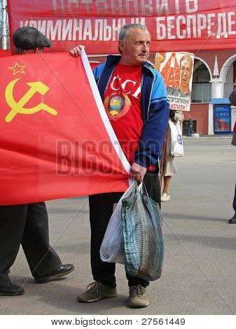 KALUGA, RUSSIA – MAY 1 : Demonstrators hold posters and flags at the annual communist meeting on the Labor Day May 1, 2009 in Kaluga.