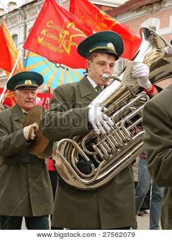 KALUGA, RUSSIA, MAY 1 : An unidentified trumpeter plays in a brass band during the procession to the Communist meeting on the Labor Day on May 1, 2009 in Kaluga, Russia.