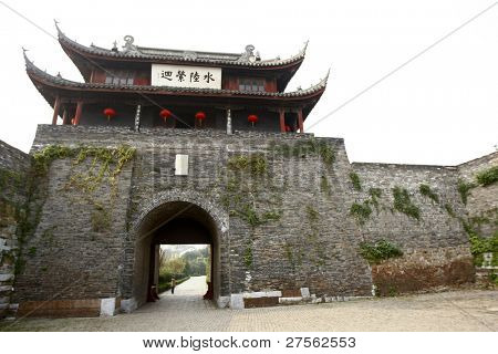 SUZHOU, CHINA - NOVEMBER 23: Tourist visits the Panmen Gate Tower, a part of the ancient city wall built in 514 BC on November 23, 2011 in Suzhou, China. The city wall surrounds and protects the city.