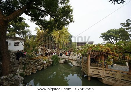 SUZHOU, CHINA - NOVEMBER 23: Tourists visit the Lion Grove Garden on November 23, 2011 in Suzhou, China. This landmark was built in 1342 in the Yuan Dynasty and was once the home of architect IM Pei.