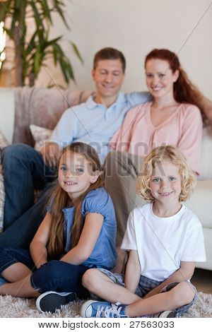 Happy young family sitting in the living room