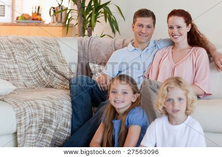 Young family sitting in the living room