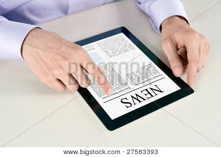 Touching Screen With News On Tablet PC