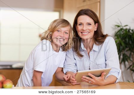 Woman and her son using tablet together