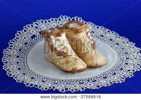 Antique Baby Shoes On Lace Doily