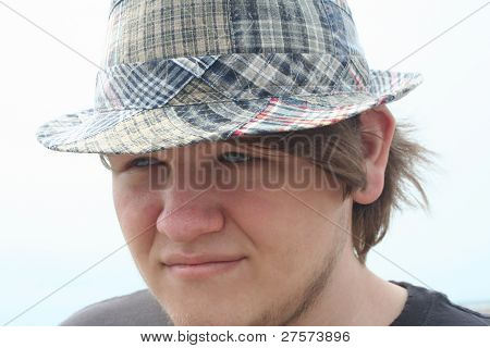 Serious Teen Boy In Plaid Hat