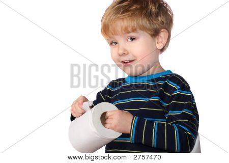 Young Boy Holding A Roll Of Toilet Paper