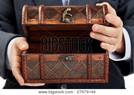 Hand Holding Treasure Chest