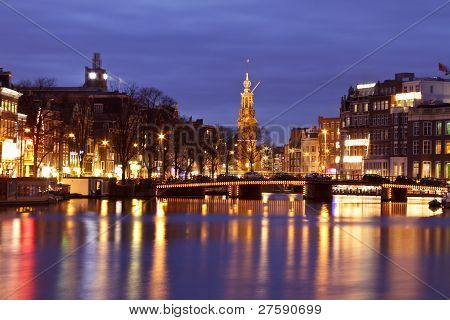 City scenic from Amsterdam with the Munt tower in the Netherlands at night