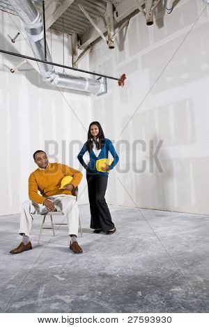 Man and woman in office space ready for build out