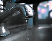 foto of water shortage  - A closeup of a park faucet dripping water - JPG