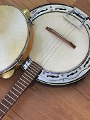 Close-up Of Two Brazilian Musical Instruments: Samba Banjo (strings) And Pandeiro (tambourine) On A  poster