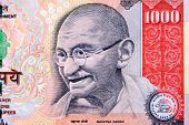 stock photo of gandhi  - Gandhi on 1000 rupee note - JPG
