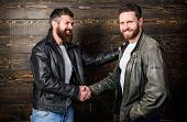 Brutal Bearded Men Wear Leather Jackets Shaking Hands. Real Men And Brotherhood. Strong Handshake. F poster