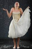picture of jupe  - beautiful girl wearing in dress with corset stands in rain and catches drops by hand - JPG