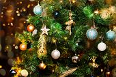 Christmas Tree Decorated With Shiny Festive Baubles, Stars And Glitter Golden Feathers Illuminated W poster