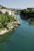 foto of mosk  - Neretva river divides old Mostar city parts - JPG
