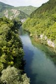stock photo of mosk  - Neretva river divides the bosnian and croats sides in Mostar - JPG