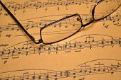 stock photo of pop up book  - Close up of Music sheet and glasses - JPG
