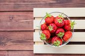 Heap Of Fresh Strawberries In Bowl On White Wooden Background. Concept Of Organic Berry And Nutritio poster