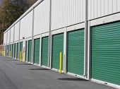 stock photo of self-storage  - Row of outdoor green door self - JPG