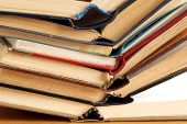 picture of dust mites  - old dusty opened books stack on table - JPG