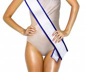stock photo of beauty pageant  - part of woman shape with white tape of beauty contest - JPG