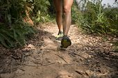 Young Fitness Woman Trail Runner Running On Rocky Trail poster