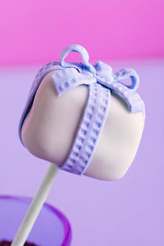 picture of cake pop  - a purple cakepop with a bow for birthday and or valentine or other celebrations - JPG