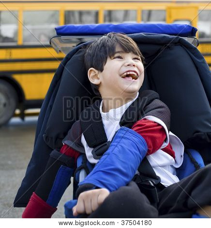Disabled Five Year Old Boy In Wheelchair, By Schoolbus