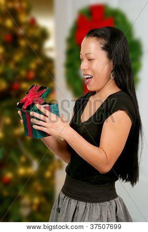 Hispanic Woman Holding A Christmas Present
