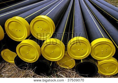 Black Plastic Pipes With Yellow Caps