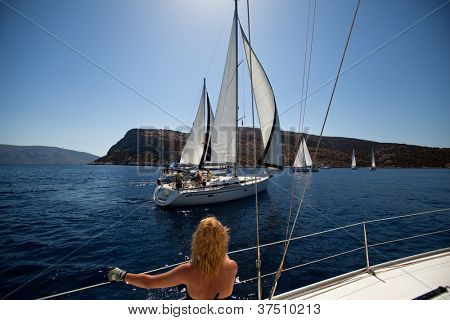SARONIC GULF, GREECE - SEPTEMBER 24: Boats Competitors During of sailing regatta