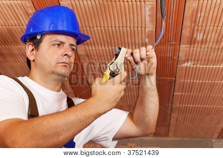 Worker Installing Electrical Wiring
