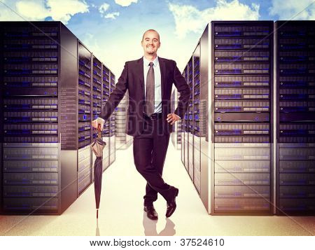 smiling man with umbrella and 3d server background