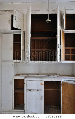 Empty Cupboards In Abandoned Kitchen