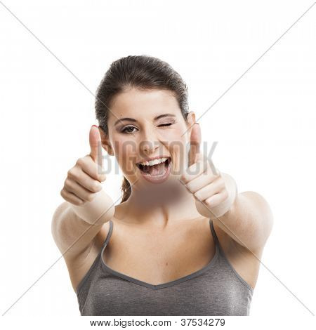 Portrait of a beautiful and happy young woman with thumbs up, isolated on white